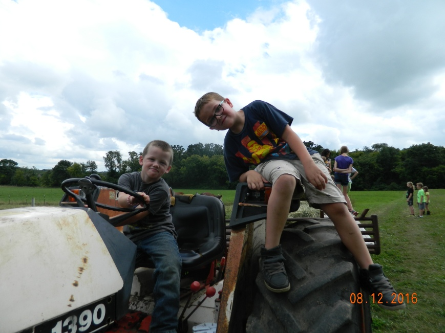 farm camp boys on tractor